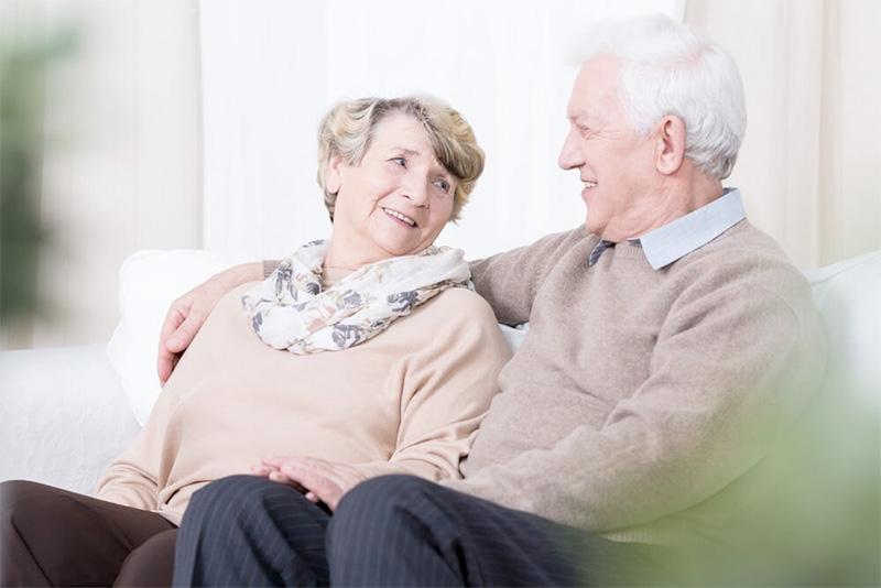 An Eldery couple sitting on a sofa